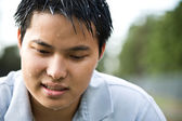 Sad depressed asian man — Stock Photo
