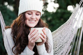 Beautiful teenager drinking coffee — Stock Photo