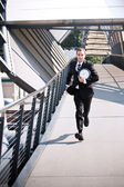 Late caucasian businessman in a rush — Stock Photo