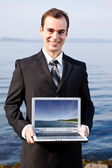 Caucasian businessman with laptop — Stock Photo