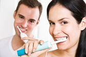 Couple brushing teeth in the bathroom — Stock Photo