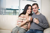 Happy couple relaxing at home — Stock Photo
