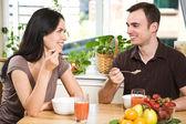 Couple eating breakfast — Stock Photo