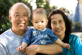 Child and grandparents — Stock Photo