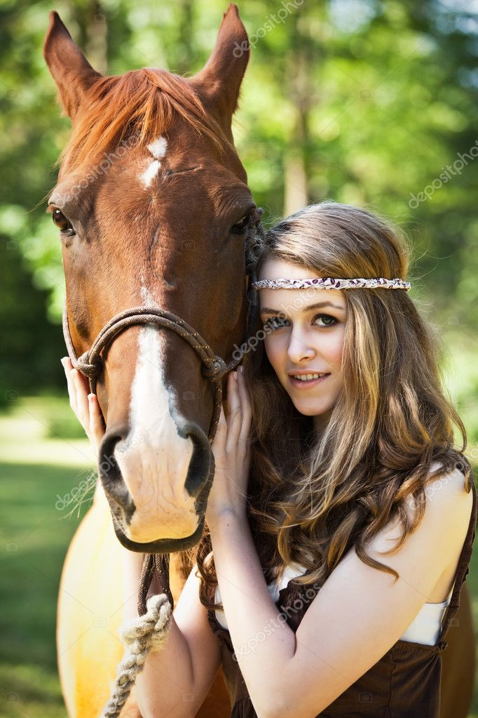 A portrait of a caucasian girl with her horse — Stock Photo #5567256