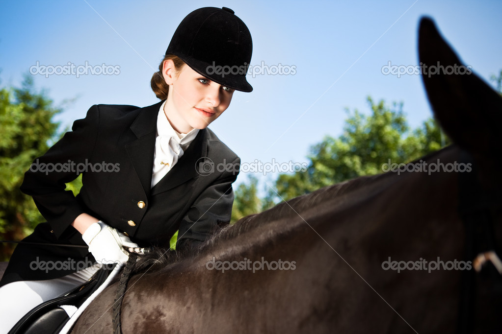 A caucasian teenage girl riding a horse outdoor — Stock Photo #5567271