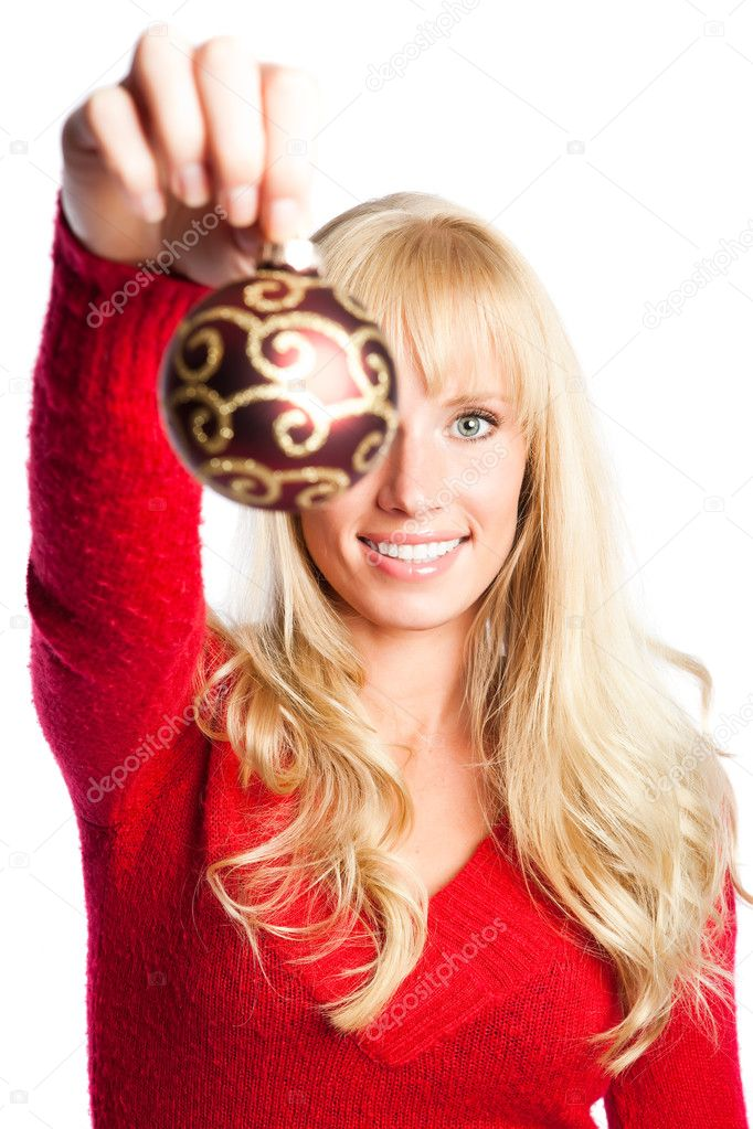 A portrait of a beautiful caucasian christmas girl holding a christmas ornament — Stock Photo #5567429