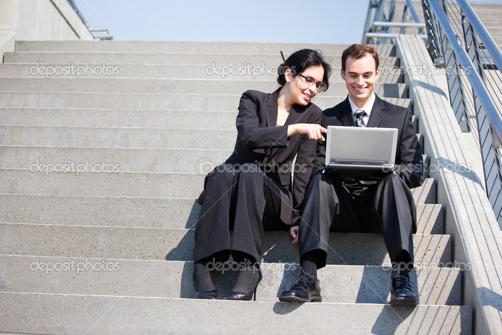 A shot of two business having a discussion outdoor — Stock Photo #5567848