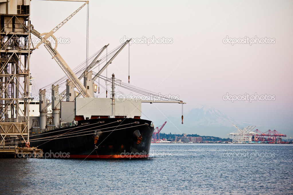 A shot of a shipping port with a ship loading or unloading shipment  Stock Photo #5568239