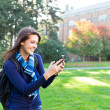 Mixed race student texting — Stock Photo