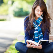 Mixed race ollege student studying — Stock Photo