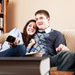 Couple watching television - Stock Photo