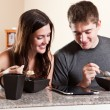Couple eating breakfast - Stock Photo