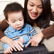 Stock Photo: Mother and son with laptop