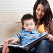 Mother and son reading — Stock Photo