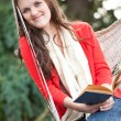 Teenager reading a book — Stock Photo #5654165