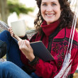 Mature woman reading a book - Stock Photo