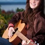 Beautiful teenager playing guitar — Stock Photo