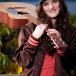 Beautiful teenager playing guitar — Stock Photo #5654207