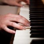 Woman playing piano — Stock Photo #5654214