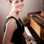 Beautiful teenager playing piano — Stock Photo #5654215