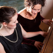 Stock Photo: Mother and daughter playing piano