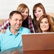 Family at home browsing internet — Stock Photo