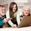 Stock Photo: senior couple shopping online