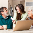 Senior couple shopping online - Stock Photo