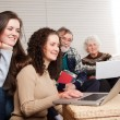 Family with laptop - Stock Photo