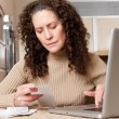 Woman paying bills — Stock Photo #5654968