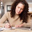 Woman paying bills — Stock Photo #5654973