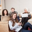 Family with wireless technology — Stock Photo
