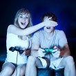 Couple playing video games - Stockfoto