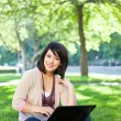 Mixed race college student with laptop — Stock Photo #5655258