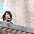Mixed race student texting — Stock Photo #5655262