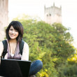 Mixed race college student with laptop — Stock Photo #5655287