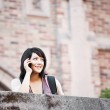 Mixed race student on the phone — Stock Photo