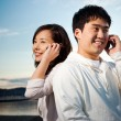 Asian couple on the phone — Stock Photo #5655491