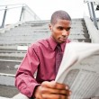 Businessman reading newspaper — Stock Photo #5655703