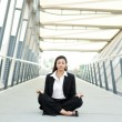Black businesswoman meditating - Stock Photo