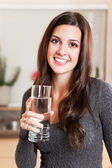Woman holding glass of water — Stock Photo