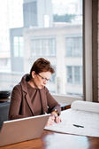 Businesswoman writing on a paper — Stock Photo