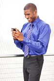 Black businesswoman texting — Stock Photo