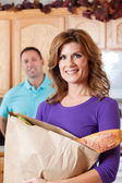 Woman with grocery — Stock Photo