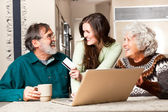 Senior couple shopping online — Stock Photo