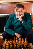 Senior man playing chess — Stock Photo