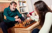 Senior playing chess — Stock Photo