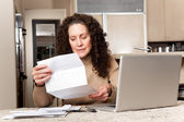 Woman paying bills — Stock Photo
