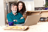 Father and daughter using laptop — Stock Photo